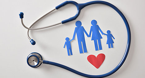 Stethoscope around a papercut out of a family and a heart